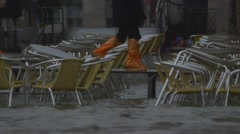 Flooded cafe, st mark's, venice, italy - sea level rise, extreme weather Stock Footage