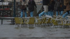 Flooding cafe chairs, st mark's, venice, italy - sea level rise - climate change Stock Footage