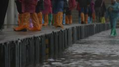 Waterproof boots on flooded footpaths, st mark's, venice, italy - sea level rise Stock Footage