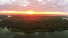 Red sunset, river and wood. Harmony of  nature .Aerial  shot  panorama Stock Footage