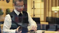 Stock Video Footage of Young businessman paying for bill and leaving cafe   HD