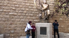 Tourists at a monument to king to David. Stock Footage