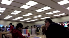 motion of people buying new iphone inside apple store - stock footage