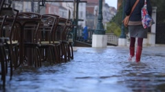 Flooding venice footpaths - gumboot tourist - sea level rise Stock Footage