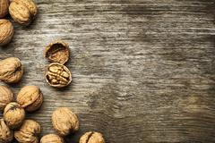 Whole nuts- walnut on a wooden table Stock Photos