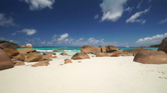 Wide sandy beach with granite rocks Stock Footage