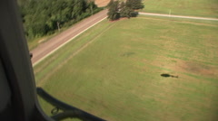 Kiowa H-58 helicopter flies above the landscape Stock Footage