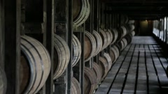 Bourbon barrels aging in a rick house in Kentucky Stock Footage