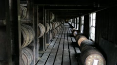 Bourbon barrels aging in a rick house in Kentucky 2 Stock Footage