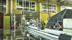 Production of Windows: the robot cuts the glass on the table automatically Stock Footage