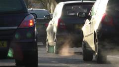 Cars coming to a stop on a cold sunny morning Stock Footage