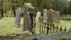 Graveyard in Scottish Highland, old with gate and grass Stock Footage