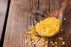 portion of yellow lentils - stock photo