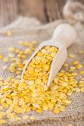 raw yellow lentils - stock photo