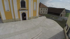 Church with a large pleasant village square Stock Footage