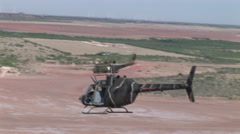 Helicopters fly in formation over desert Stock Footage