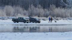 Fishermen Walking Along Snowy River Bank in Alaska Stock Footage