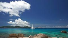 Catamaran sailing between islands Stock Footage
