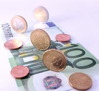 Studio shot of complete set of euro coins on 100 euro bank note. symbol for e Stock Photos