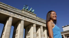 Berlin runner woman resting after running in  Germany by Brandenburg Gate Stock Footage