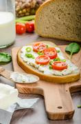 fresh bread smeared with cream cheese - stock photo