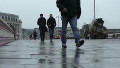 Commuters walking home on a cold wet afternoon Stock Footage