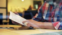 Man reading food menu sitting in cafe HD Arkistovideo