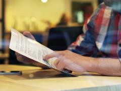 Man reading food menu sitting in cafe NTSC Arkistovideo