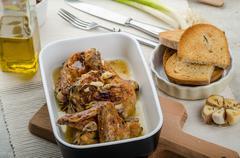 roasted chicken parts with bio garlic, herb-garlic toast - stock photo