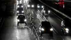 Night time traffic car headlights Stock Footage