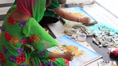 Students draws from nature the image of the Golden Temple. Amritsar, India Stock Footage