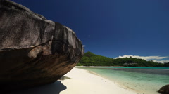 Tropical lagoon beach and granite rock Stock Footage