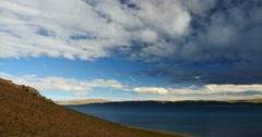 4k huge dark clouds mass rolling over lake namtso & mountain,tibet mansarovar. Stock Footage