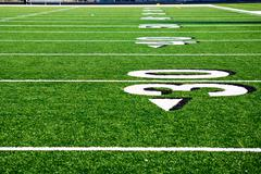 thirty yard line at football field - stock photo