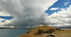 4k huge clouds mass rolling over lake namtso & peninsula,tibet mansarovar. Stock Footage