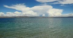 4k huge clouds mass rolling over lake namtso & mountain,tibet mansarovar. Stock Footage