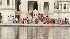 Sikhs and indian people visiting the Golden Temple in Amritsar, Punjab, India. Stock Footage