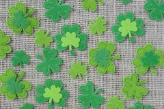 green clover on burlap background - stock photo