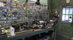 Key display on wall at local key cutting shop Stock Footage