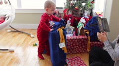 family on christmas morning opening presents - stock footage