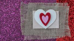 hearts with burlap on pink wood background - stock photo