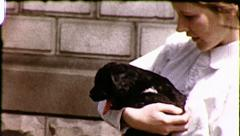 PUPPY LOVE Pretty Girl Holds Pet Cute Dog Vintage Film Retro Home Movie 8084 Stock Footage
