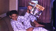 Boy Reading MAD MAGAZINE 1960s Vintage Retro Film Home Movie 8085 Stock Footage