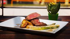 Delicious Filet Mignon with asparagus and fingerling potatoes Stock Photos