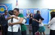 June 13, 2014 The First Lady and the President hug Native American youth foll Stock Photos