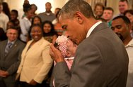 June 23, 2014 The President kisses a baby girl as he and the Vice President g Stock Photos