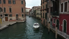 Venice Italy boats narrow canal homes fast 4K 016 - stock footage