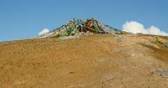 4k prayer flag at the lake namtso peninsula mountain in tibet. Stock Footage