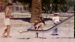 Children on Playground Slide 1970s Vintage Film Home Movie Film 8087 Stock Footage