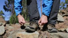 Hiking shoes - man tying hiking boots and walking Stock Footage